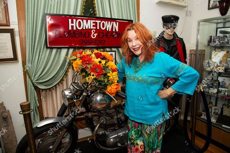 Stock Picture of Miss Pamela Des Barres poses for portraits before her creative writing workshop at the James Dean Gallery, in Fairmont, Ind
