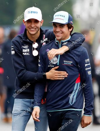 French Formula One driver Esteban Ocon (L) of Sahara Force India F1 Team and Canadian Formula One driver Lance Stroll (R) of Williams walk through the paddock at the Suzuka Circuit in Suzuka, central Japan, 04 October 2018. The Japanese Formula One Grand Prix will take place on 07 October.