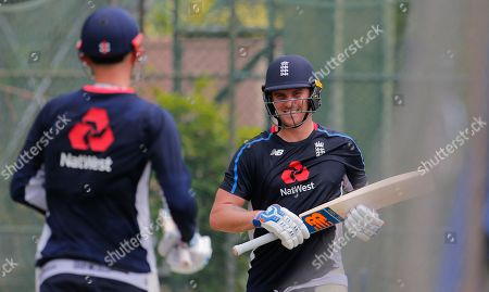 England's Jason Roy, right, speaks with Alex Hales as they attend a practice session in Colombo, Sri Lanka