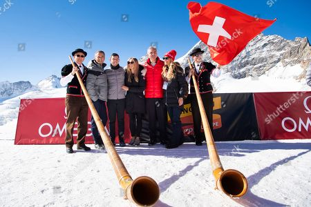 Omega CEO Raynald Aeschlimann (2-L), Rory McIlroy from Northern Ireland (C), his wife Erica Stoll (2-R) and Jungfraubahn Holding AG CEO Urs Kessler (R) pose during a golf event on the Aletsch glacier, 3'454 meters above sea level on the Jungfraujoch, Switzerland, 04 October 2018.