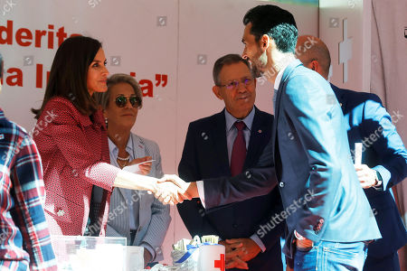 Spanish Queen Letizia (L) greets Real Madrid's former soccer player Alvaro Arbeloa (R) as she presides a Red Cross stall during the Spanish Red Cross Little Flag Day in Madrid, Spain, 04 October 2018.