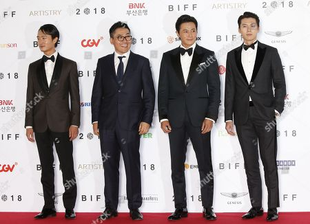 (L-R) South Korean actor Cho Woo-jin, South Korean director Kim Sung-hoon, South Korean actors Jang Dong-gun and Hyun bin arrive for the opening ceremony of the 23rd Busan International Film Festival (BIFF) in Busan, South Korea, 04 October 2018. The BIFF will screen 323 films from 79 countries and runs from 04 to 13 October 2018.