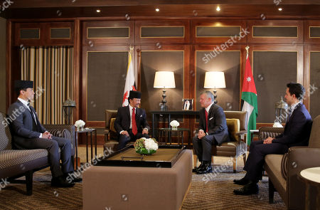 King Abdullah II of Jordan (2-R ) meets with the Sultan of Brunei Hassan Bolkiah (2-L ) acccompanied by Crown Prince of Jordan Al Hussein bin Abdullah (R) and son of the Sultan of Brunei Abdul Mateen (L) at al-Husseiniya Palace, Amman, Jordan, 04 October 2018. Sultan of BRunei is in Jordan for an official visit.