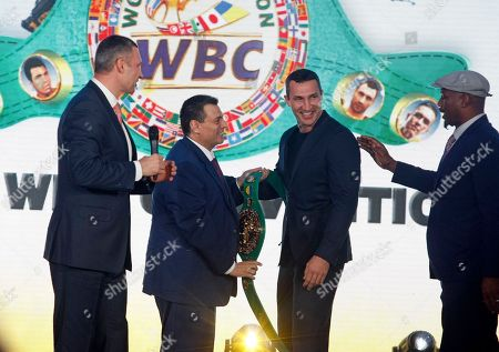 Mauricio Sulaiman, President of the World Boxing Council (WBC) (2-L) is seen giving the WBC honorary champion belt to Wladimir Klitschko, Ukrainian boxing Champion (2-R), while Vitali Klitschko, former heavyweight boxing champion and current Mayor of Kiev (L) and Lennox Lewis, former Boxing Champion (R) look on, during ceremony of opening of the 56th WBC Convention in Kiev, Ukraine.