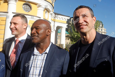 Vitali Klitschko, former heavyweight boxing champion and current Mayor of Kiev (L), Evander Holyfield, former Boxing Champion(C) and Wladimir Klitschko, Ukrainian boxing Champion (R) take part at ceremony of opening of the 56th WBC Convention in Kiev.