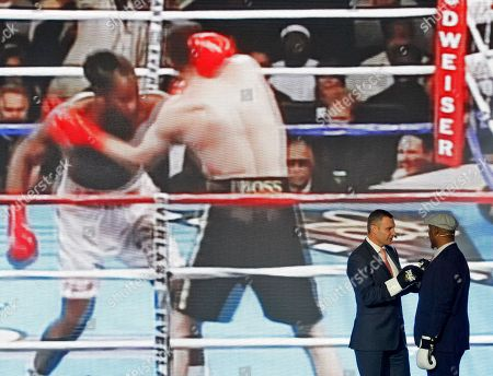 Lennox Lewis, former Boxing Champion (R) and Vitali Klitschko, former heavyweight boxing champion and current Mayor of Kiev (L) seen as they look on screen remembering their fight on 2003, during ceremony of opening of the 56th WBC Convention in Kiev.