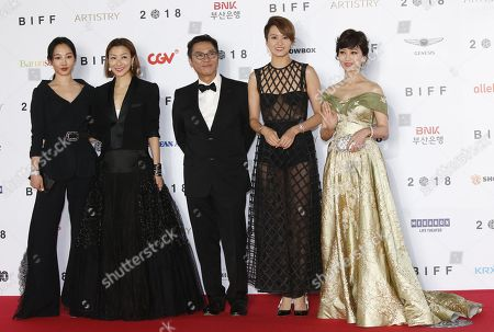 (L-R) Chinese actress Bai Baihe, Chinese actress Sammi Cheng, Chinese director Stanley Kwan, Chinese singer and actress Leung Gigi and Chinese actress Angie Chiu  arrive for the opening ceremony of the 23rd Busan International Film Festival (BIFF), in Busan, South Korea, 04 October 2018. The BIFF will screen 323 movies from 79 countries and runs from 04 to 13 October.