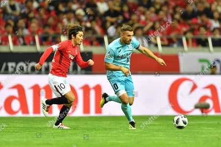 Yosuke Kashiwagi (Reds), Lukas Podolski (Vissel) - Football / Soccer : 2018 J1 League match between Urawa Red Diamonds 4-0 Vissel Kobe at Saitama Stadium 2002 in Saitama, Japan.
