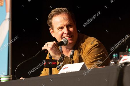"""Chris Henchy speaks on stage at the """"Impractical Jokers"""" panel during the first day of New York Comic Con"""