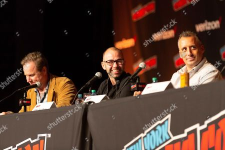 """From left, Chris Henchy, James Murray, and Joe Gatto look on at the """"Impractical Jokers"""" panel during the first day of New York Comic Con"""