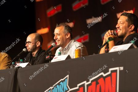 """Joe Gatto, center, speaks on stage while Sal Vulcano and James Murray look on at the """"Impractical Jokers"""" panel during the first day of New York Comic Con"""