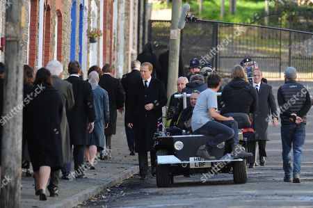 Tobias Menzies (centre) who plays Prince Philip, with the cast of Netflix series The Crown during rehearsals in Cwmaman, Wales, UK.Filming of Netflix series The Crown, in the town of Cwmaman, south Wales, UK.