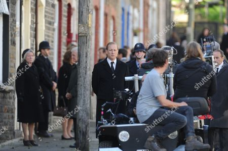 Tobias Menzies (C) who plays Prince Philip, with the cast of Netflix series The Crown during rehearsals in Cwmaman, Wales, UK.Filming of Netflix series The Crown, in the town of Cwmaman, south Wales, UK.