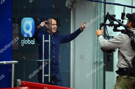 Johnny Vaughan filming outside Global studios