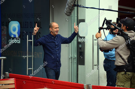 Stock Photo of Johnny Vaughan filming outside Global studios