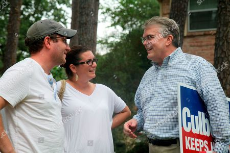 Jim and Claire Silliman speak with nine-term incumbent Rep. John Culberson, R-Texas, who was campaigning on foot through the neighborhoods of the Texas 7th congressional district in Houston. Culberson is locked in a tight race against his Democratic challenger Lizzie Pannill Fletcher in district which voted for Hillary Clinton in the 2016 presidential election