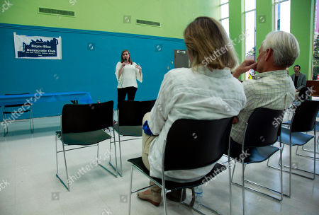 Lizzie Pannill Fletcher, a Democrat is challenging longtime Rep. John Culberson for his seat in Texas 7th congressional district, speaks during an assembly of the Bayou Blue Democratic Club in Houston. The race could test how far women angry at Trump will go embracing a candidate they might otherwise shun