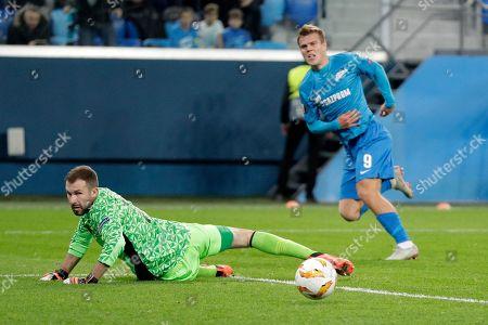 Zenit's Aleksandr Kokorin, right, scores the opening goal of his team during the Europa League Group C soccer match between FC Zenit and Slavia Prague at Saint Petersburg stadium in Saint Petersburg, Russia