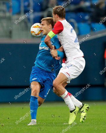 Slavia's Tomas Soucek, right, tries to stop Zenit's Aleksandr Kokorin during the Europa League Group C soccer match between FC Zenit and Slavia Prague at Saint Petersburg stadium in Saint Petersburg, Russia