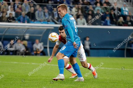 Zenit's Aleksandr Kokorin (9) goes to score the opening goal of his team during the Europa League Group C soccer match between FC Zenit and Slavia Prague at Saint Petersburg stadium in Saint Petersburg, Russia