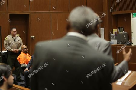 Stock Image of Former rap mogul Marion 'Suge' Knight, 53, looks toward a victim family member who is giving a statement as he appears in court for sentencing after he pleaded no contest to manslaughter for running over Terry Carter with his truck during an argument near the set of the movie biopic 'Straight Outta Compton' in Los Angeles, California, USA, 04 October 2018. Knight was sentenced to 28 years in prison.