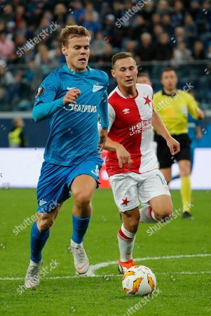 Aleksandr Kokorin (L) of FC Zenit in action against Jan Boril (R) of SK Slavia during the UEFA Europa League Group C soccer match between FC Zenit St. Petersburg and SK Slavia Prague in St. Petersburg, Russia, 04 October 2018.