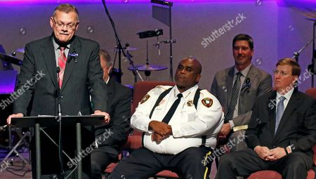 Stock Picture of Dan Perry, Kenneth Collins, Tate Reeves. Rev. Dan Perry delivers his comments while Brookhaven, Miss., Police Chief Kenneth Collins, seated center, and Lt. Gov. Tate Reeves, right, listen during funeral services, for Brookhaven Police Corporal Zach Moak at Easthaven Baptist Church in Brookhaven, Miss. Moak and officer James White were killed early Saturday, Sept. 30, responding to a call