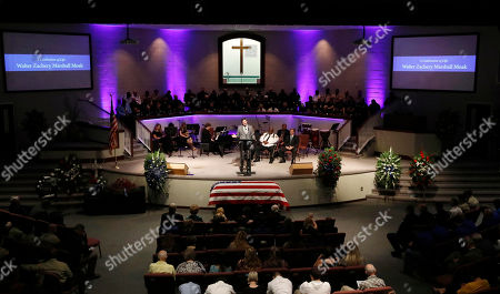 Stock Picture of Rev. Jeff Davis delivers a prayer during funeral services, for Brookhaven Police Corporal Zach Moak at Easthaven Baptist Church in Brookhaven, Miss. Moak and officer James White were killed early Saturday, Sept. 30, responding to a call