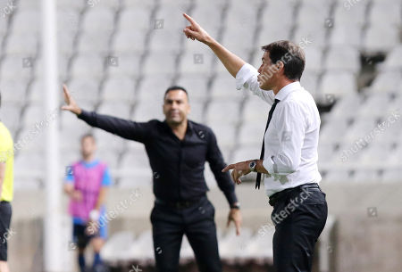 Marseille's head coach Rudi Garcia (R) and Apollon Limassol's head coach Sofronis Avgousti (L) react during the UEFA Europa League Group H soccer match between Apollon Limassol FC and Marseille at the GSP stadium in Nicosia, Cyprus, 04 October 2018.