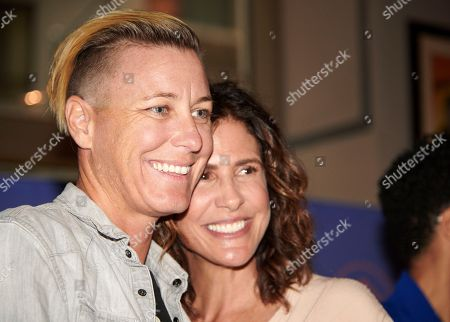 Abby Wambach and Together Founder, Jennifer Rudolph Walsh smile for a picture at an event hosted by Hello Sunshine x Together Live on