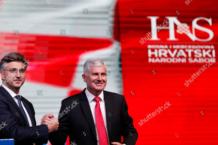 Andrej Plenkovic, Dragan Covic. Croatia's Prime Minister Andrej Plenkovic, left, shakes hands with Dragan Covic, presidential candidate of the Croatian Democratic Union (HDZ), during a political rally of the Croatian Democratic Union of Bosnia and Herzegovina in Mostar, Bosnia, on