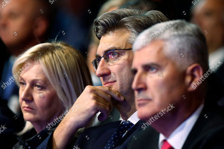 Stock Picture of Andrej Plenkovic, Dragan Covic. Croatia's Prime Minister Andrej Plenkovic, center, and Dragan Covic, presidential candidate of the Croatian Democratic Union (HDZ), right, attend a political rally of the Croatian Democratic Union Presidential in Mostar, Bosnia, on . Bosnia holds a general election this weekend that could cement ethnic divisions of the 1992-95 war as a pro-Russian nationalist bids for a top post and politicians cling to war-era rivalries rather than reform needed to pull the country out of the post-war limbo