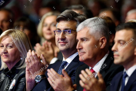 Andrej Plenkovic, Dragan Covic. Croatia's Prime Minister Andrej Plenkovic, center, and Dragan Covic, presidential candidate of the Croatian Democratic Union (HDZ), right, attend a political rally of the Croatian Democratic Union Presidential in Mostar, Bosnia, on . Bosnia holds a general election this weekend that could cement ethnic divisions of the 1992-95 war as a pro-Russian nationalist bids for a top post and politicians cling to war-era rivalries rather than reform needed to pull the country out of the post-war limbo