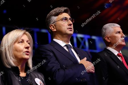 Andrej Plenkovic, Dragan Covic. Croatia's Prime Minister Andrej Plenkovic, center, Dragan Covic, presidential candidate of the Croatian Democratic Union (HDZ), right, and Borjana Kristo, left, attend a political rally of the Croatian Democratic Union Presidential in Mostar, Bosnia, . Bosnia holds a general election this weekend that could cement ethnic divisions of the 1992-95 war as a pro-Russian nationalist bids for a top post and politicians cling to war-era rivalries rather than reform needed to pull the country out of the post-war limbo