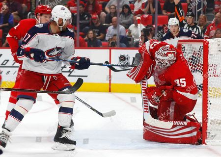 Detroit Red Wings goaltender Jimmy Howard (35) stops a shot by Columbus Blue Jackets center Brandon Dubinsky (17) during the first period of an NHL hockey game, in Detroit