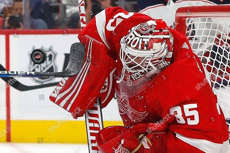 Detroit Red Wings goaltender Jimmy Howard (35) stops a Columbus Blue Jackets center Brandon Dubinsky (17) shot in the first period of an NHL hockey game, in Detroit