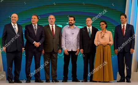 Brazilian presidential candidates pose for a photo before a live, televised debate in Rio de Janeiro, Brazil, ahead of Oct. 7 general elections. From left are Henrique Meirelles of the Democratic Movement Party, Alvaro Dias of Podemos Party, Ciro Gomes of the Democratic Labor Party, Guilherme Boulos of the Socialism and Liberty Party, Geraldo Alckmin of the Social Democratic Party, Marina Silva of the Sustainability Network Party and Fernando Haddad of the Worker's Party