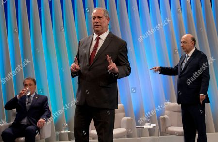 Ciro Gomes, presidential candidate of the Democratic Labor Party, center, Henrique Meirelles, presidential candidate of the Democratic Movement Party, right, and Alvaro Dias, presidential candidate of Podemos Party get ready for a live, televised presidential debate in Rio de Janeiro, Brazil, . Brazil will hold general elections on Oct. 7