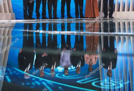 The candidates for the Presidency of Brazil are shown reflected on the floor, (L-R) Henrique Meirelles, Alvaro Dias, Ciro Gomes, Guilherme Boulos, Geraldo Alckmin, Marina Silva and Fernando Haddad, while posing for photographs on their arrival to their last debate on television, at the TV Globo facilities, in Rio de Janeiro, Brazil, 04 October 2018. The main candidates for the Brazilian Presidency participate in the last debate on television before the elections on 07 October, and again without the presence of the far-right candidate Jair Bolsonaro, leader in the polls and who did not attend due to a medical recommendation.