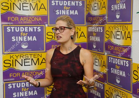 Democratic Rep. Kyrsten Sinema, who is running against Republican Rep. Martha McSally for the open Arizona Senate seat Jeff Flake, R-Ariz., is vacating, talks to campaign volunteers, in Tempe, Ariz. Arizona's Senate race pits Sinema, a careful politician running as a centrist in a Republican-leaning state, against McSally, a onetime Trump critic turned fan