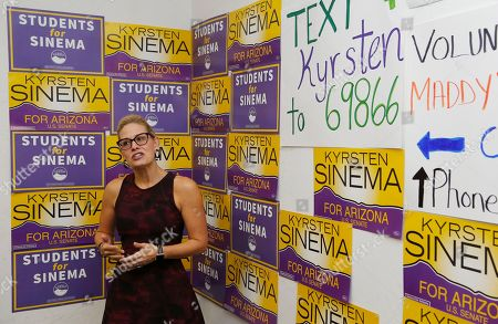 Stock Picture of Democratic Rep. Kyrsten Sinema, who is running against Republican Rep. Martha McSally for the open Arizona Senate seat Jeff Flake, R-Ariz., is vacating, talks to campaign volunteers, in Tempe, Ariz. Arizona's Senate race pits Sinema, a careful politician running as a centrist in a Republican-leaning state, against McSally, a onetime Trump critic turned fan