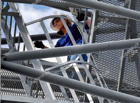 Stock Image of U.S. Rep. Martha McSally, R-Ariz., who is running against U.S. Rep. Kyrsten Sinema, D-Ariz., for the senate seat being vacated by retiring U.S. Sen. Jeff Flake, R-Ariz., climbs atop a crane at a crane manufacturing and training facility, in Phoenix. Arizona's Senate race pits Sinema, a careful politician running as a centrist in a Republican-leaning state, against McSally, a onetime Trump critic turned fan
