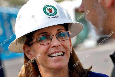 U.S. Rep. Martha McSally, R-Ariz., who is running against U.S. Rep. Kyrsten Sinema, D-Ariz., for the senate seat being vacated by retiring U.S. Sen. Jeff Flake, R-Ariz., talks to employees at a crane manufacturing and training facility, in Phoenix. Arizona's Senate race pits Sinema, a careful politician running as a centrist in a Republican-leaning state, against McSally, a onetime Trump critic turned fan