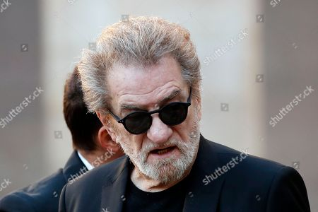 French singer Eddy Mitchell arrives to ceremony to pay tribute to late singer Charles Aznavour Oct.5, 2018 in Paris. Aznavour, the French crooner and actor whose performing career spanned eight decades and who seduced fans around the world with his versatile tenor, lush lyrics and kinetic stage presence, has died. He was 94