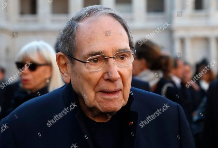 French actor Robert Hossein leaves after a ceremony to pay tribute to late singer Charles Aznavour, Friday, Oct.5, 2018 in Paris. France paid tribute to Charles Aznavour on Friday in a solemn and subdued ceremony that contrasted sharply with the singer's joyful character