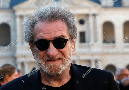 French singer Eddy Mitchell leaves after a ceremony to pay tribute to late singer Charles Aznavour, Friday, Oct.5, 2018 in Paris. France paid tribute to Charles Aznavour on Friday in a solemn and subdued ceremony that contrasted sharply with the singer's joyful character