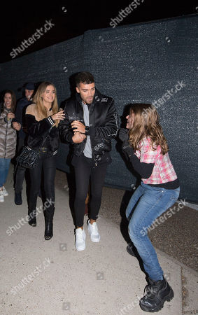 Josh Cuthbert & Chloe Lloyd are chased by Scare Actors at the launch of Thorpe Park Resort's annual Fright Nights season.