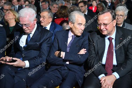 Member of the Constitutional Council Lionel Jospin (C), former President of the Constitutional Council Robert Badinter (R) sit at the Constitutional Council in Paris