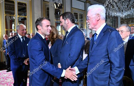 French President Emmanuel Macron (L) greets the member of the Constitutional Council Lionel Jospin at the Constitutional Council in Paris