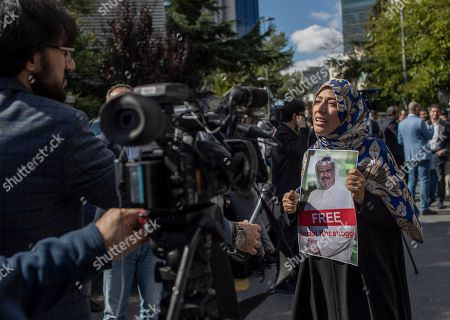 Yemeni Nobel Prize winner Tawakkol Karman (R) speaks to media as she holds a picture of Saudi Journalist Jamal Khashoggi, during a demonstration organized by Turkish-Arabic Media Association in front of the Saudi Arabian consulate in Istanbul, Turkey, 05 October 2018. According to reports, Jamal Khashoggi, a Saudi journalist known for being a critic of his country's policies, has gone missing after visiting the Saudi consulate in Istanbul on 02 October 2018 to complete routine paperwork.